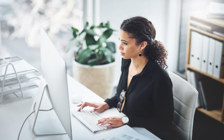 woman working on content marketing at computer